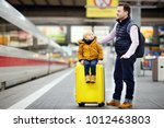 cute little boy and his father... | Shutterstock . vector #1012463803