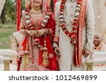 indian groom dressed in white... | Shutterstock . vector #1012469899
