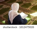 elderly woman praying in the... | Shutterstock . vector #1012475020