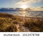 beautiful sunset on the sandy... | Shutterstock . vector #1012478788