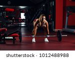 young woman exercising with... | Shutterstock . vector #1012488988