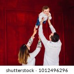 mom  dad and their little son... | Shutterstock . vector #1012496296