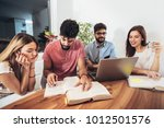 group of students study at home.... | Shutterstock . vector #1012501576