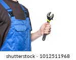 man mechanic in working clothes ... | Shutterstock . vector #1012511968