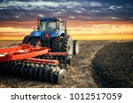 Tractor Working On The Farm ...