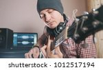 young male musician composes... | Shutterstock . vector #1012517194