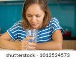 dissatisfied woman looking into ... | Shutterstock . vector #1012534573