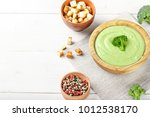cream soup of broccoli on a... | Shutterstock . vector #1012538170