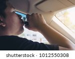man taking health drink while... | Shutterstock . vector #1012550308