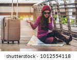 lost woman traveller making... | Shutterstock . vector #1012554118