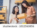 two young asian people startup... | Shutterstock . vector #1012563856