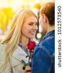spring couple walking park....   Shutterstock . vector #1012573540