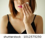 young woman remove  cosmetic... | Shutterstock . vector #1012575250