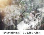 a man in a cassock spends a... | Shutterstock . vector #1012577254