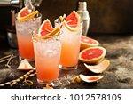 grapefruit cocktail in tall... | Shutterstock . vector #1012578109