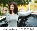 happy female driver showing car ... | Shutterstock . vector #1012581160