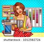 vector pop art woman tailor... | Shutterstock .eps vector #1012582726