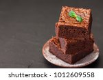 chocolate brownie square pieces ... | Shutterstock . vector #1012609558