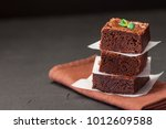 chocolate brownie square pieces ... | Shutterstock . vector #1012609588