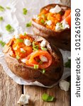 baked sweet potato stuffed with ... | Shutterstock . vector #1012610980