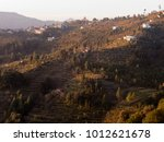 first sunbeams over mukteshwar... | Shutterstock . vector #1012621678