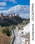 Small photo of La Alhambra palace on top of the hill, in Granada, Andalucia, Spain