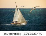 Sail Yacht At Sunset With...