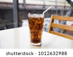 cola and ice tubes in the glass ... | Shutterstock . vector #1012632988
