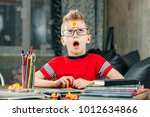 the little boy was thinking ... | Shutterstock . vector #1012634866