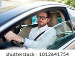 smiling young man wearing...   Shutterstock . vector #1012641754