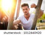 attractive man in urban setting ...   Shutterstock . vector #1012660420
