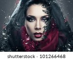 mysterious woman in black hood with gemstones - stock photo