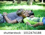 father with his son in the park | Shutterstock . vector #1012676188