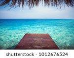 wooden pier with sea background ... | Shutterstock . vector #1012676524