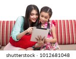 teacher and her student use... | Shutterstock . vector #1012681048