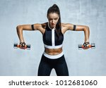 athletic woman doing exercise... | Shutterstock . vector #1012681060
