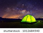 glowing green camping tent on... | Shutterstock . vector #1012684540