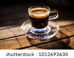 glass coffee cup with an... | Shutterstock . vector #1012693630