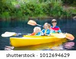 child with paddle on kayak.... | Shutterstock . vector #1012694629
