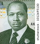 Small photo of Daniel Toroitich arap Moi portrait on Kenyan 10 shillings (1990) banknote closeup macro, second President of Kenya.