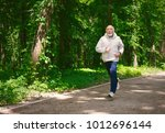 elderly sporty man running in... | Shutterstock . vector #1012696144