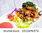 thai basil fried chicken with... | Shutterstock . vector #1012696576