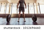 man with barbell in health club.... | Shutterstock . vector #1012696660