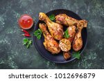 Grilled chicken legs with...