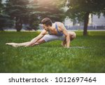 fitness man at stretching... | Shutterstock . vector #1012697464