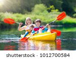 child with paddle on kayak.... | Shutterstock . vector #1012700584
