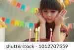 cute little girl cover her face ... | Shutterstock . vector #1012707559