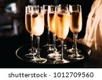 waiter carrying a tray with a... | Shutterstock . vector #1012709560