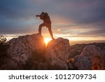 photographer in mountain at... | Shutterstock . vector #1012709734