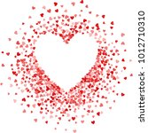red frame of scatter confetti... | Shutterstock . vector #1012710310